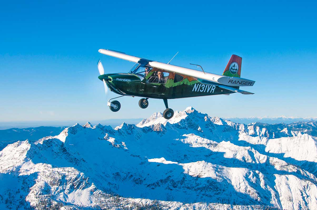 The S-LSA Ranger R7 flies around its home near Mt. Baker in Washington state